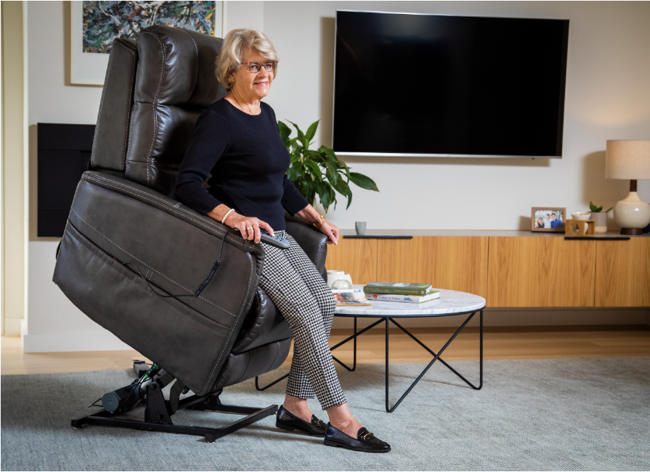 Woman standing up from riser recliner chair
