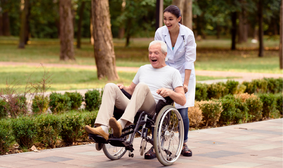 A carer and person on a wheelchair